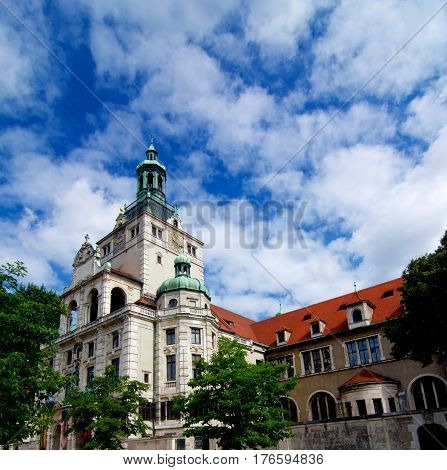 Building of Bavarian National Museum Bottom up View against Cloudy Blue Sky Outdoors. Munich Germany