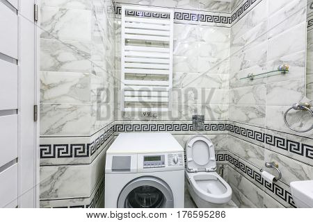 Stock photo white and black small bathroom with washing machine, chisinau, moldova