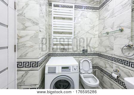 Stock photo white and black small bathroom with washing machine, chisinau, moldova