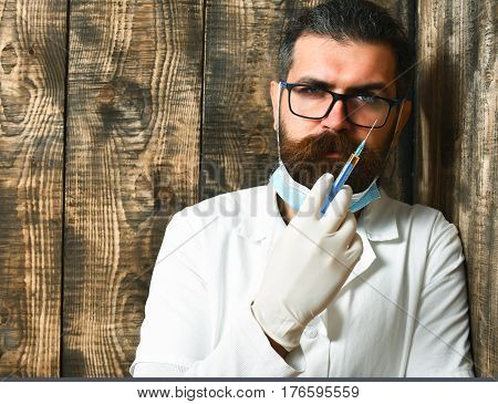 Bearded Brutal Caucasian Doctor Or Postgraduate Student Holding Pills