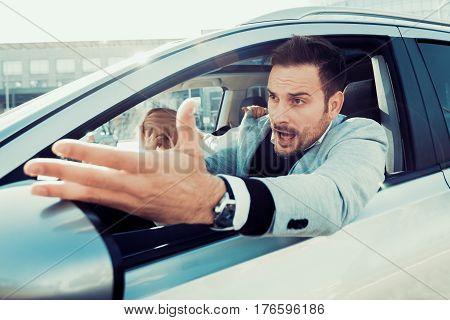 Dangerous city traffic situation, man driving car