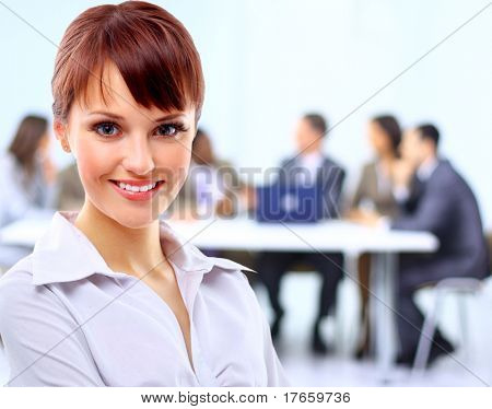 Portrait of a cute young business lady looking happy at office