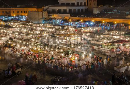Famous square Jemaa El Fna busy with many people and lights during the night, medina of Marrakesh, Morocco.