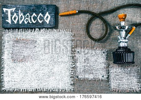 Template with hookah, dark wood signboards and white burlap squares as frames on gray burlap background. Wooden title bar with text 'Tobacco'. Rustic style flat pattern