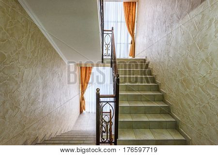 Stairs and hallway of the apartment house with metal railings in chisinau, moldova
