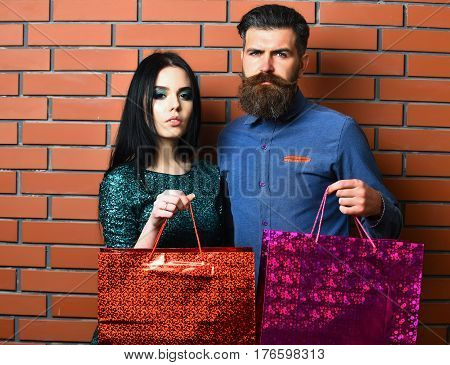 Bearded Man And Pretty Sexy Woman With Shopping Bags, Packages