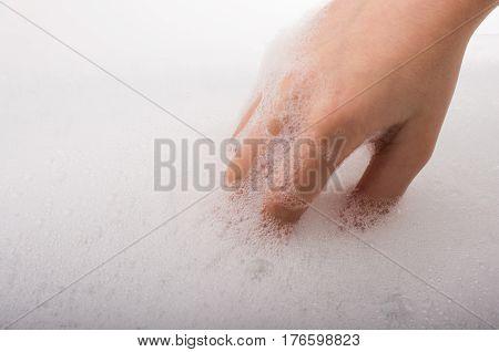 Child Washing Hands  In Foam