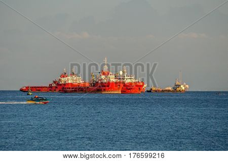 Labuan,Malaysia-March 15,2017:Offshore oil & gas sea construction & support vessel at port of Labuan,Malaysia.All the vessels port in Labuan island,most related to the offshore Oil & Gas industry.