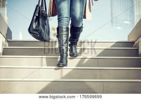 Close-up of businesswoman with a briefcase in the city. Hurrying to work.