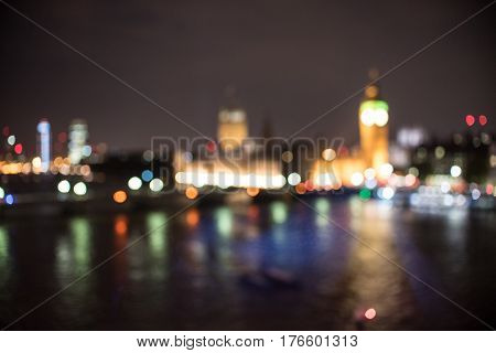 Blurry London England at night over the Thames River