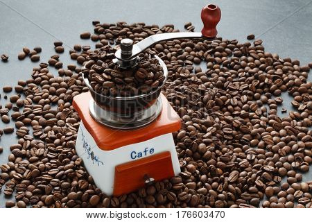 Scattering Of Coffee Beans With Hands Mill