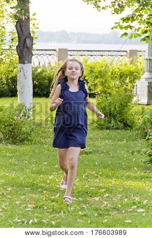 Cute running European girl with disheveled hair in summer