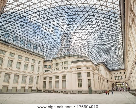 Madrid Spain - November 16 2014: Main Court of Madrid City Hall covered with a glass skylight. Low angle view.