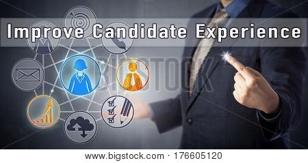 Male consultant in blue shirt and business suit is recommending to Improve Candidate Experience. Human resources management metaphor and business concept for offering a great recruitment experience.
