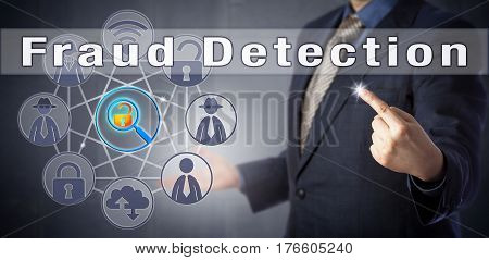 Male forensic expert in blue shirt is initiating Fraud Detection. Information technology metaphor and computer crime concept for the detection of fraudulent internet activity via forensic analysis.
