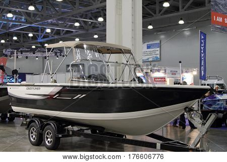 MOSCOW - MARCH 09 2017: Boat Crestliner 2150 Sportfish SST for 10 International boat show in Moscow. Russia.