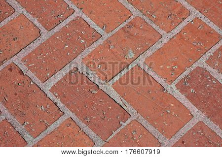 Closeup of Design on a Red Brick Walkway