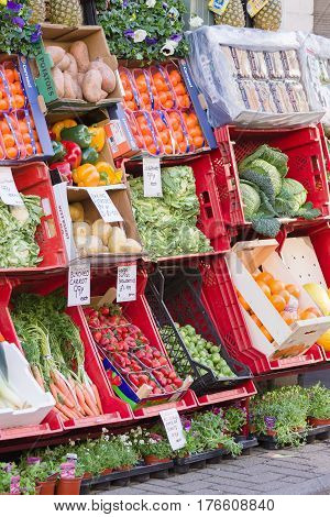 Wales UK - March 15 2017: Traditional fresh fruit and vegetables pavement display outside a small independent Welsh green grocers shop. Pavement displays have long been used to display produce.