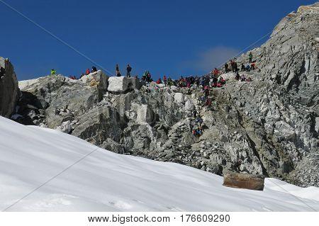 Many trekker crossing Cho La mountain pass Nepal. Popular trekking route in the Everest National Park.