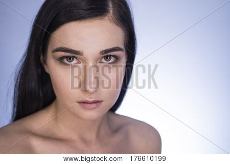 Beautiful Girl. Portrait Of A Girl In Make-up Beauty On A Blue Background