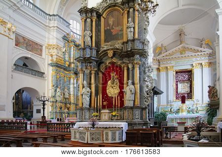 GRODNO BELARUS - SEPTEMBER 02 2012: Interior with the altar and icons. Roman Catholic St. Francis Xavier's cathedral Grodno Belarus.