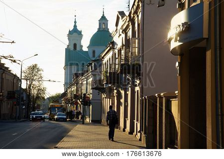 Grodno Belarus - September 02 2012: Grodno view of the street with old houses and a church. Belarus.