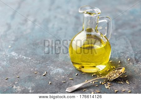 Fennel seeds oil in bottle close up