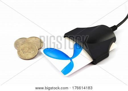 Card reader with card and coins isolated on white background