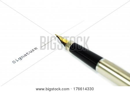 A form of a document with a place for a signature and a gold nibbed pen