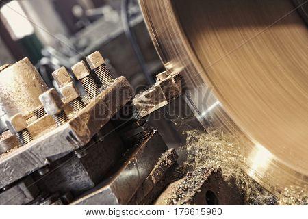 Lathe machine cutting iron taken closeup.Toned image.