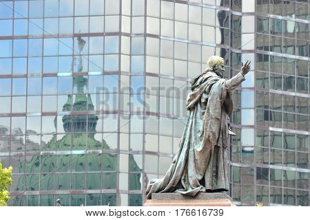 The statue and exterior domes reflected by glass of The Cathedral-Basilica of Mary, Queen of the World. (French: Cathedrale Marie-Reine-du-Monde) in Montreal, Quebec, Canada.