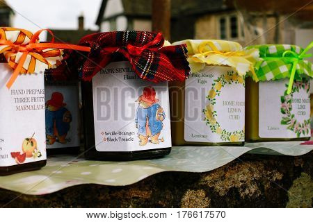 LACOCK, UK - MARCH 11, 2017: Homemade chutney, marmalade and jam for sale in small village of Lacock, England. Buyer are asked to pay for products into honesty box.