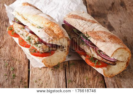 Sandwiches With Fried Mackerel, Tomatoes And Onions Close-up. Horizontal