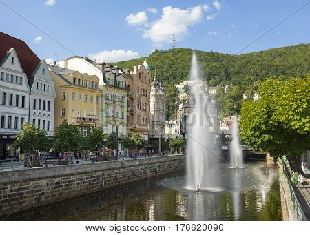 Karlovy Vary Czech republic - July 18 2016: Tepla River with fountains and Promenade street in Karlovy Vary Czech republic July 18 2016