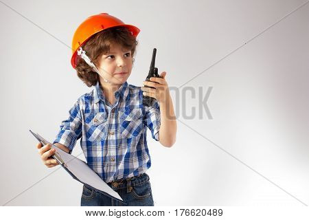 Cute little foreman looks up and says over the radio. Gray background.