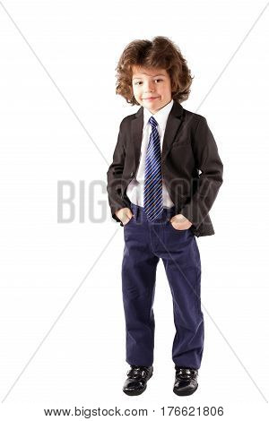Curly cute boy standing and looking into the camera in an unbuttoned jacket. White background.