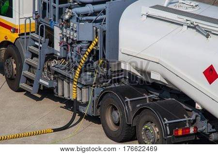 DUESSELDORF NRW GERMANY - MARCH 18 2015: Aviation fuel truck on during refueling of an aircraft at Duesseldorf Airport in Germany.