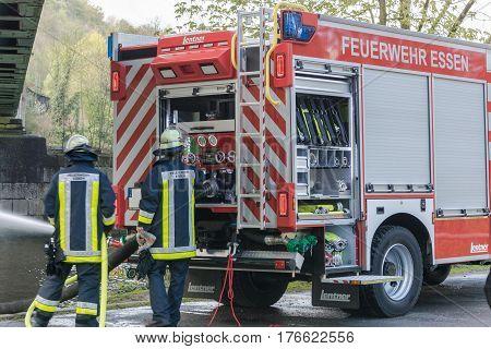 ESSEN KETTWIG NRW GERMANY - APRIL 28 2016: Fire fighter trainer use in Essen Kettwig Germany. Firefighters in Uniform during training.