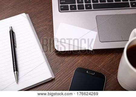 Blank business card design mockup. Visiting card, smartphone and laptop. Business branding template. Cup of coffee.