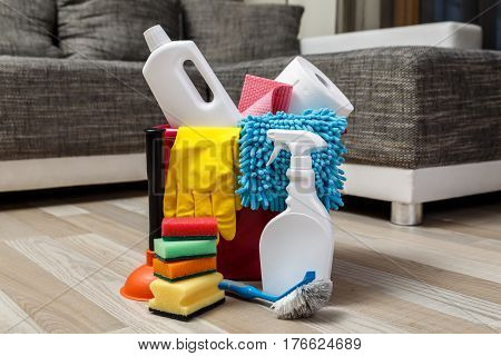 Cleaning service. Bucket with sponges, chemicals bottles and plunger. Rubber gloves and paper towel. Household equipment.