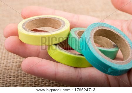 Colorful Insulating Adhesive Tapes  In Hand