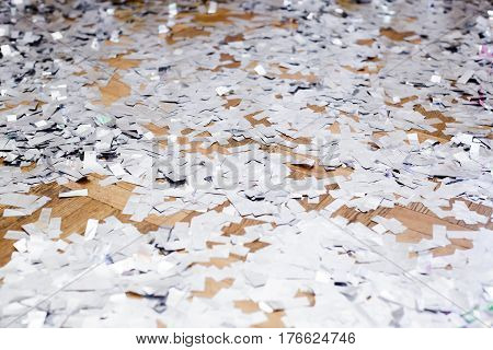 the silver confetti on the floor. background