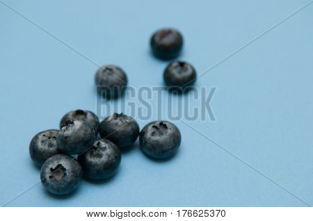 Blueberry Isolated On Blue, Rich In Antioxidants