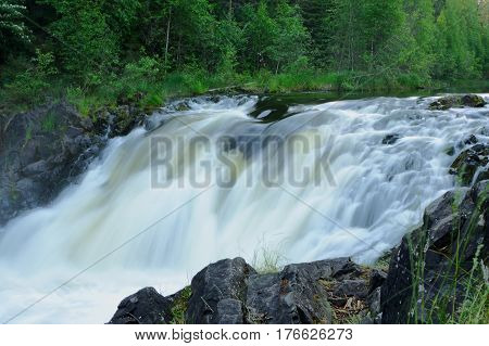 Stormy threshold of rapid waterfall In Karelia