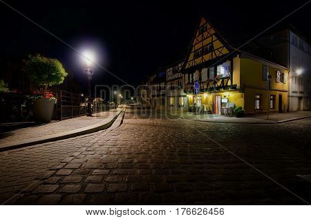 Embankment of fish-traders in Colmar city, Alsace,  France at night. Street lights are burning.