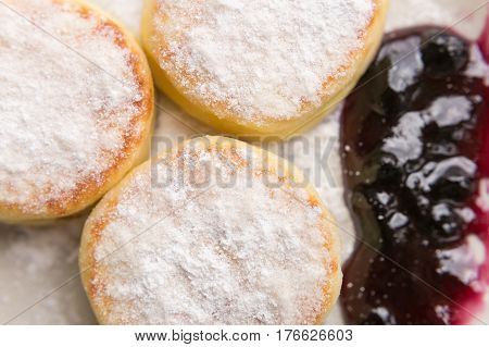 Food photo. Plate of fresh cheese pancakes with icing sugar. Breakfast concept. Sweet dessert. Curds fritters on a white dish. Cheese cake. Cottage cheese.