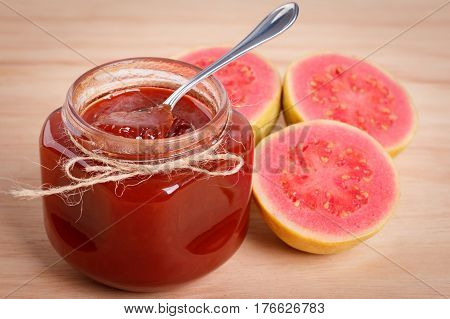 Brazilian dessert goiabada - jam of guava with fresh goiaba on wooden background. Selective focus