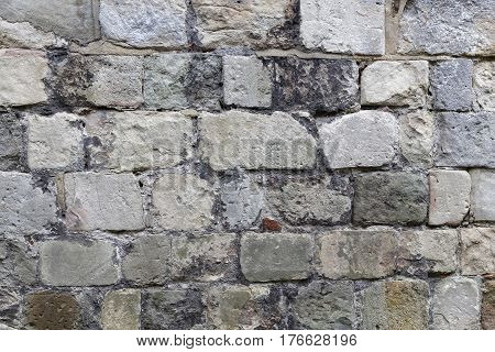 Stone wall made of gray stones of different shape
