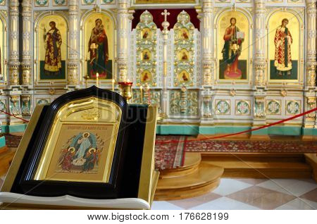 Valaam Island Karelia Russia - June 12 2014: Christian Church of the Resurrection monastery consecrated in honor of the Resurrection of Christ. Extraordinary light airy porcelain iconostasis is framed in gold.