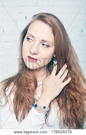 Girl with red hair showing demonstrating jewelry